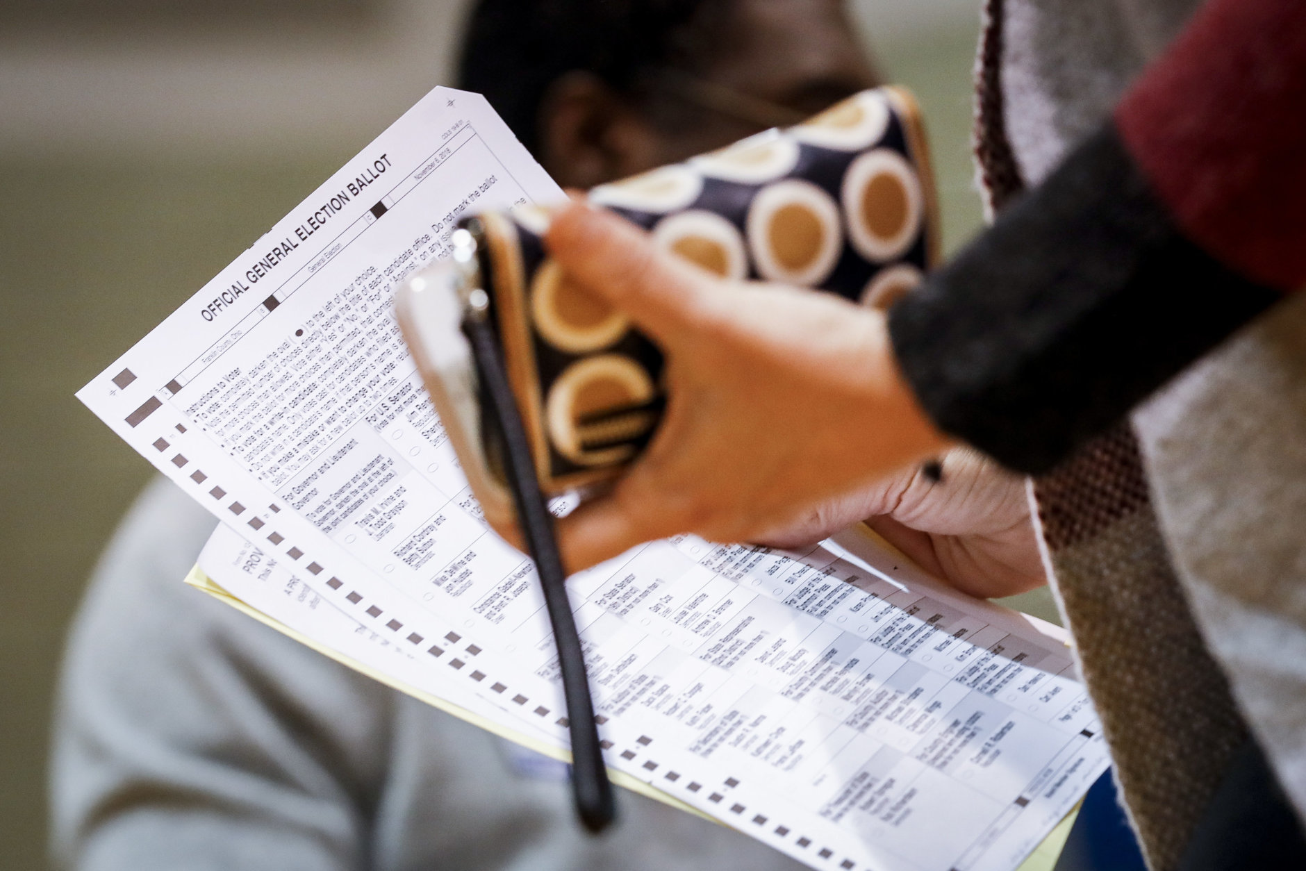 A voter prepares to fill out her ballot at the Whetstone Community Center polling location, Tuesday, Nov. 6, 2018, in Columbus, Ohio. Across the country, voters headed to the polls Tuesday in one of the most high-profile midterm elections in years. (AP Photo/John Minchillo)