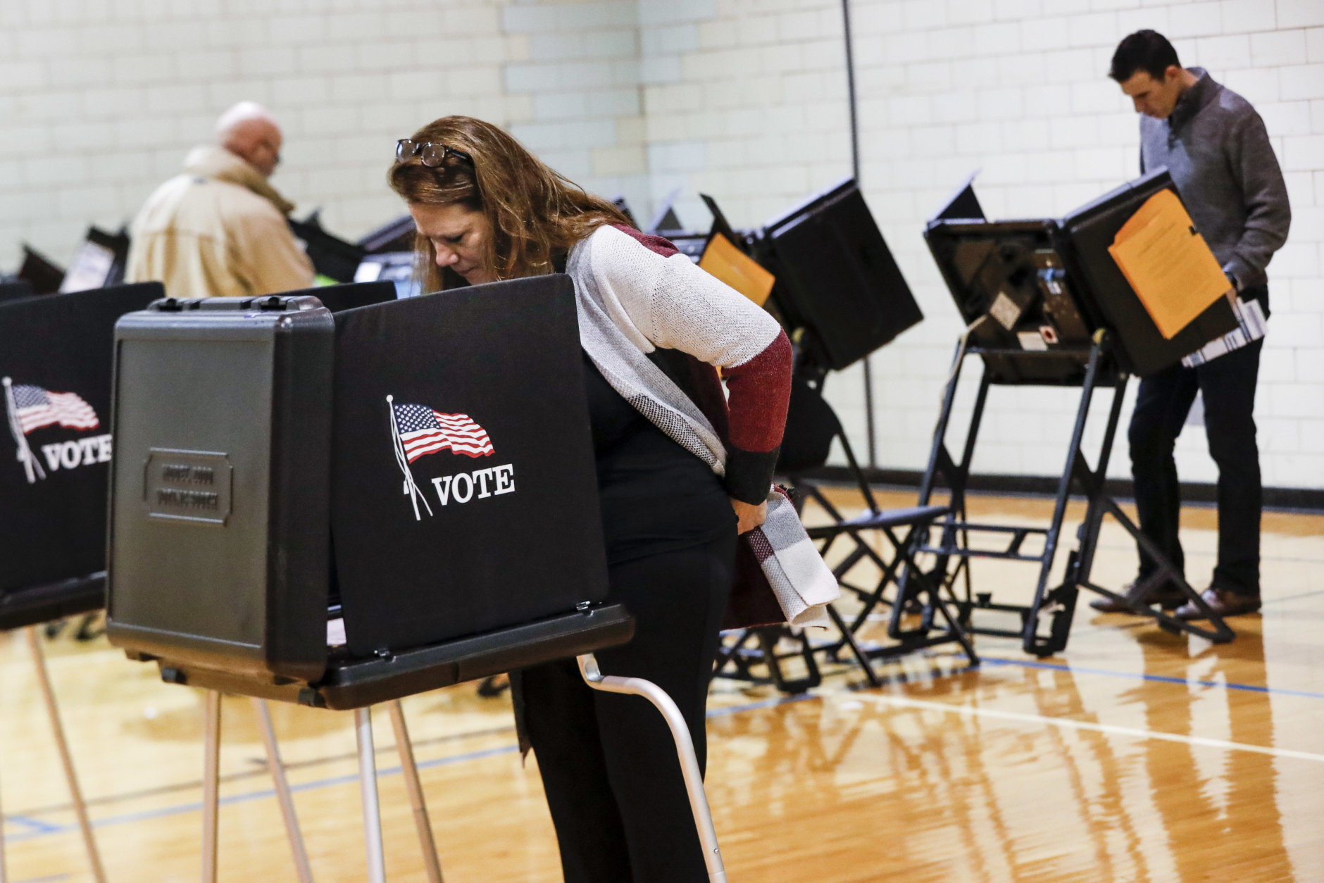 Voters fill out their ballots at the Whetstone Community Center polling location, Tuesday, Nov. 6, 2018, in Columbus, Ohio. Across the country, voters headed to the polls Tuesday in one of the most high-profile midterm elections in years. (AP Photo/John Minchillo)