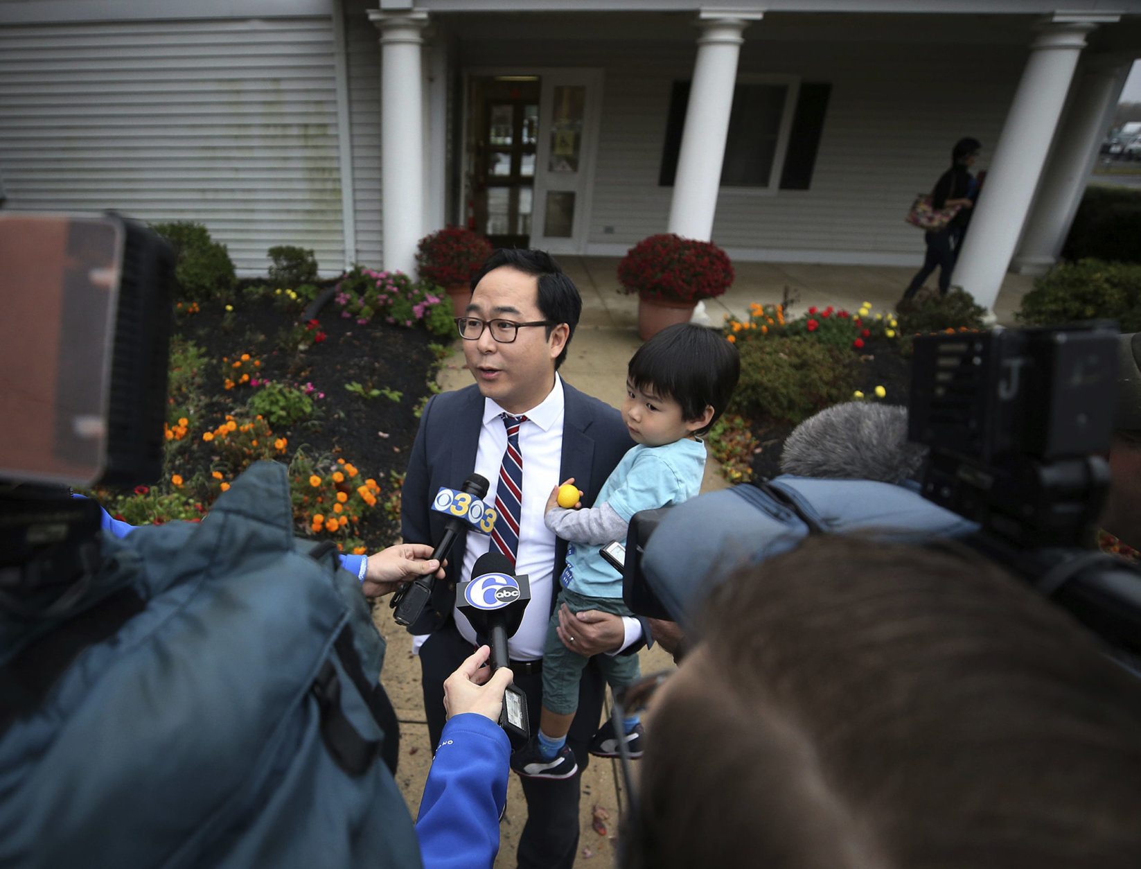 Andy Kim, the Democratic candidate in New Jersey's third Congressional District, holds his son Austin Kim, as addresses the media after voting Tuesday, Nov. 6, 2018, in Bordentown, N.J. Kim is facing Tom MacArthur, the Republican incumbent candidate in New Jersey's third Congressional District. (AP Photo/Mel Evans)