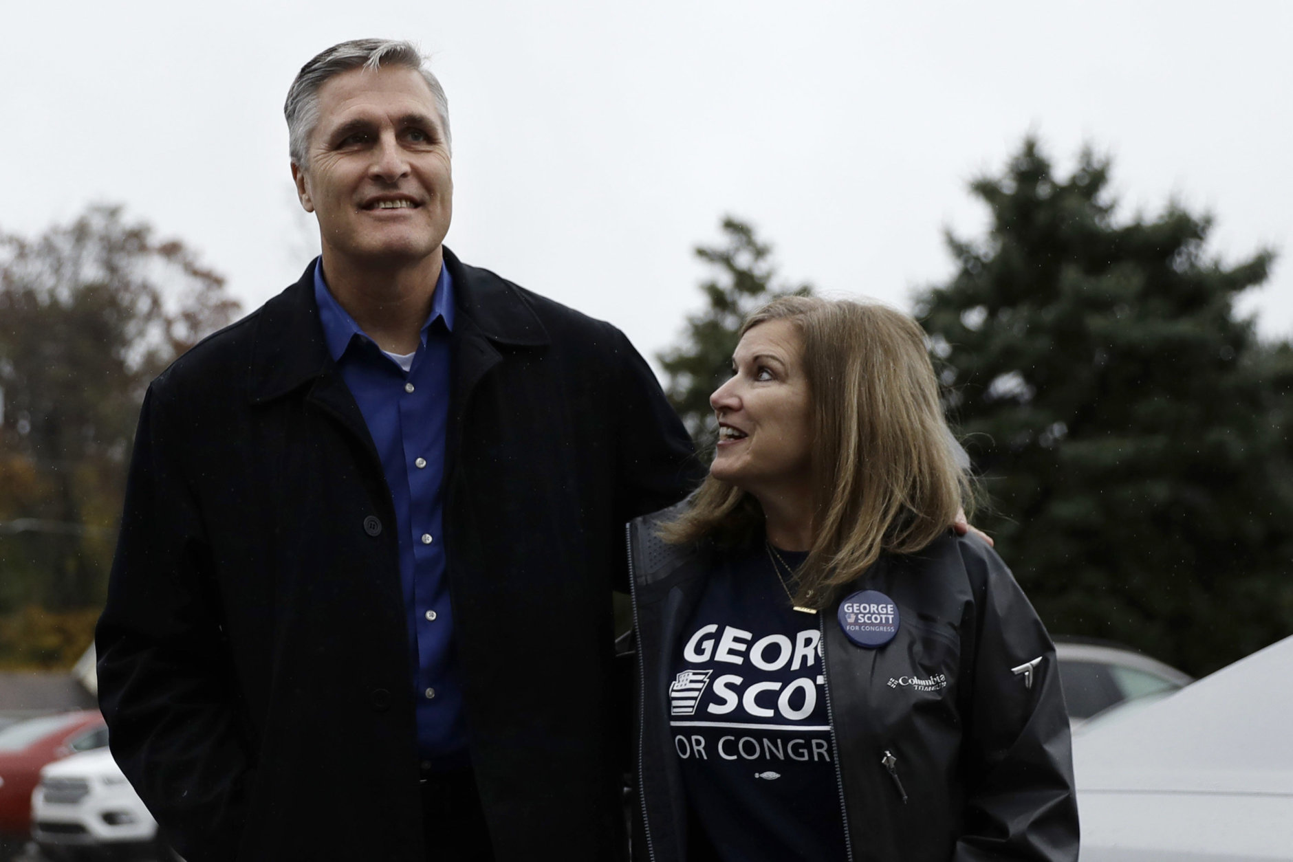 George Scott, left, Democratic candidate for Pennsylvania's 10th Congressional District, and his wife, Donna Scott, walk to vote at Celebration Community Church, Tuesday, Nov. 6, 2018, in Dillsburg, Pa. (AP Photo/Matt Slocum)