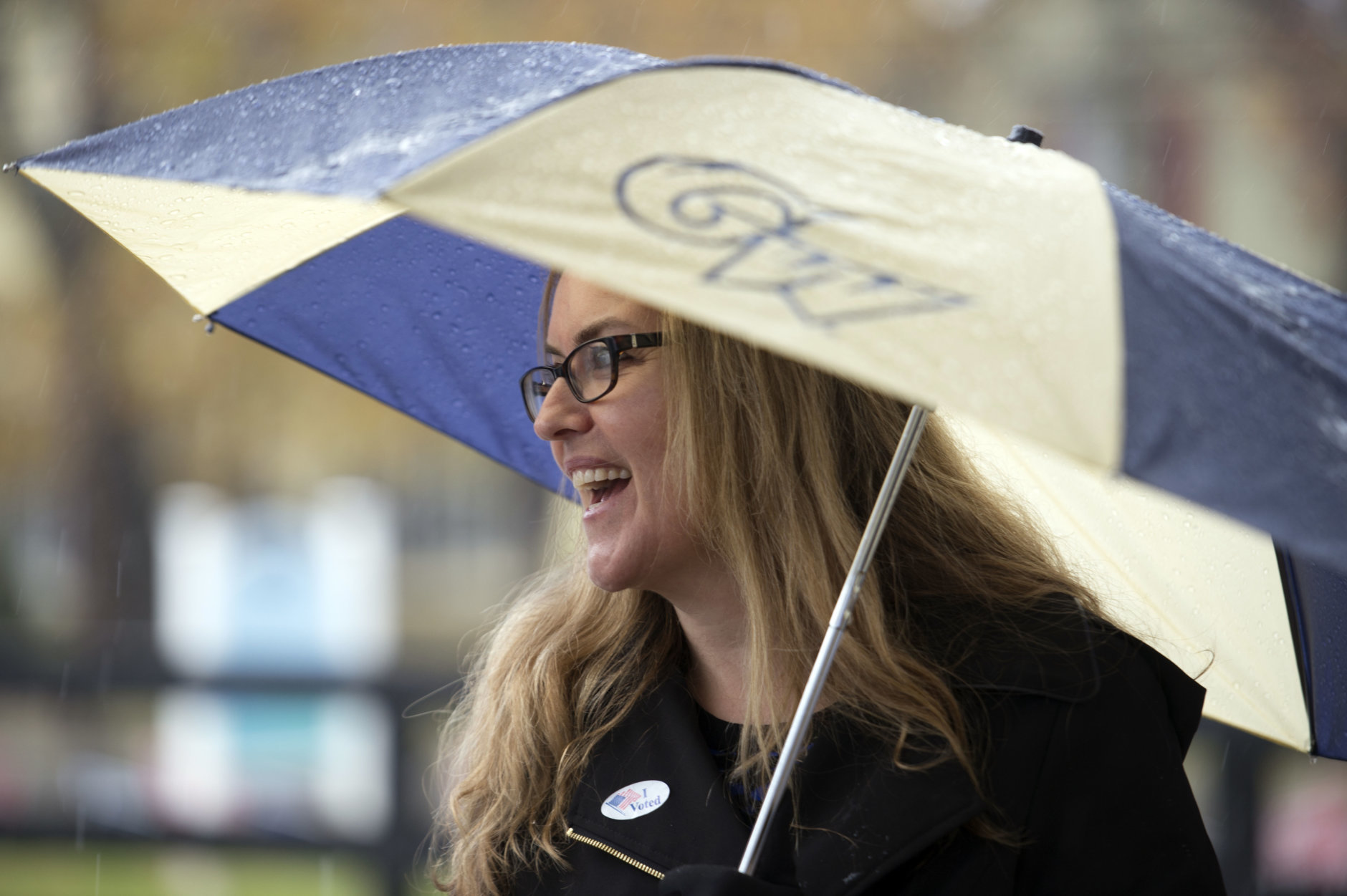 Virginia Democratic congressional candidate Jennifer Wexton, a former prosecutor and current Democratic state senator, greets voters at the Clarke County School Offices, Tuesday, Nov. 6, 2018 in Berryville, Va. Wexton is running against two-term Rep. Barbara Comstock, R-Va. (AP Photo/Douglas Graham)