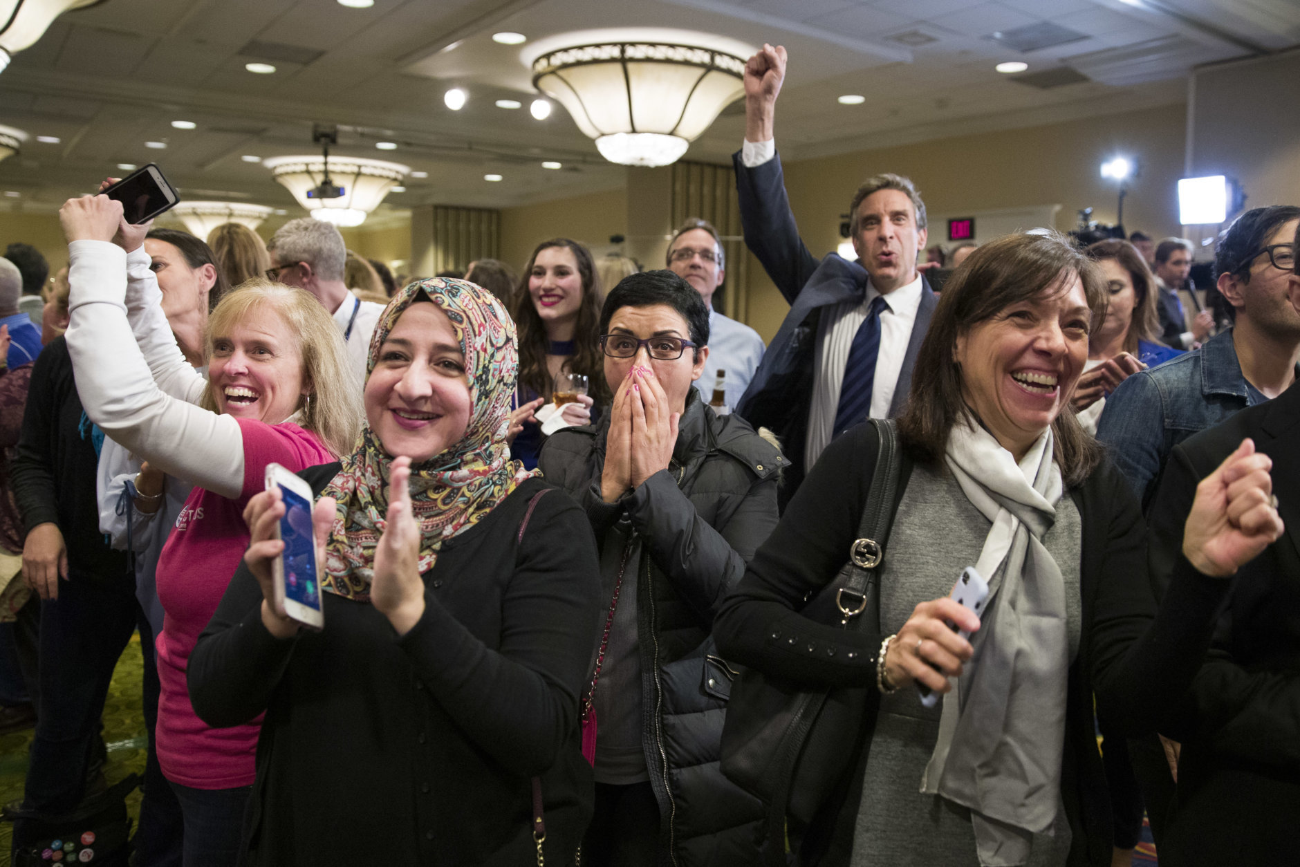 Supporters cheer as they watch returns at an election night party for Democrat congressional candidate Jennifer Wexton, Tuesday, Nov. 6, 2018, in Dulles, Va. (AP Photo/Alex Brandon)