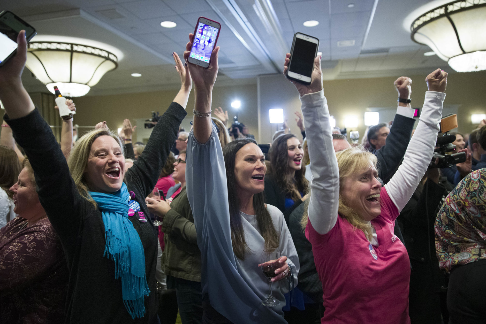 Supporters cheer as they watch returns at an election night party for Democrat congressional candidate Jennifer Wexton on Tuesday, Nov. 6, 2018, in Dulles, Va. (AP Photo/Alex Brandon)