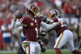 Washington Redskins quarterback Alex Smith (11) throws a pass as he is pressured by Tampa Bay Buccaneers defensive tackle Gerald McCoy (93) during the first half of an NFL football game Sunday, Nov. 11, 2018, in Tampa, Fla. (AP Photo/Jason Behnken)