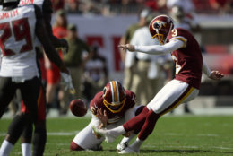 Washington Redskins' Dustin Hopkins (3) kicks a field goal against the Tampa Bay Buccaneers during the first half of an NFL football game Sunday, Nov. 11, 2018, in Tampa, Fla. (AP Photo/Jason Behnken)