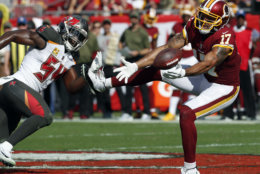 Washington Redskins wide receiver Michael Floyd (17) reaches for the ball after getting around Tampa Bay Buccaneers outside linebacker Lavonte David (54) during the first half of an NFL football game Sunday, Nov. 11, 2018, in Tampa, Fla. (AP Photo/Mark LoMoglio)
