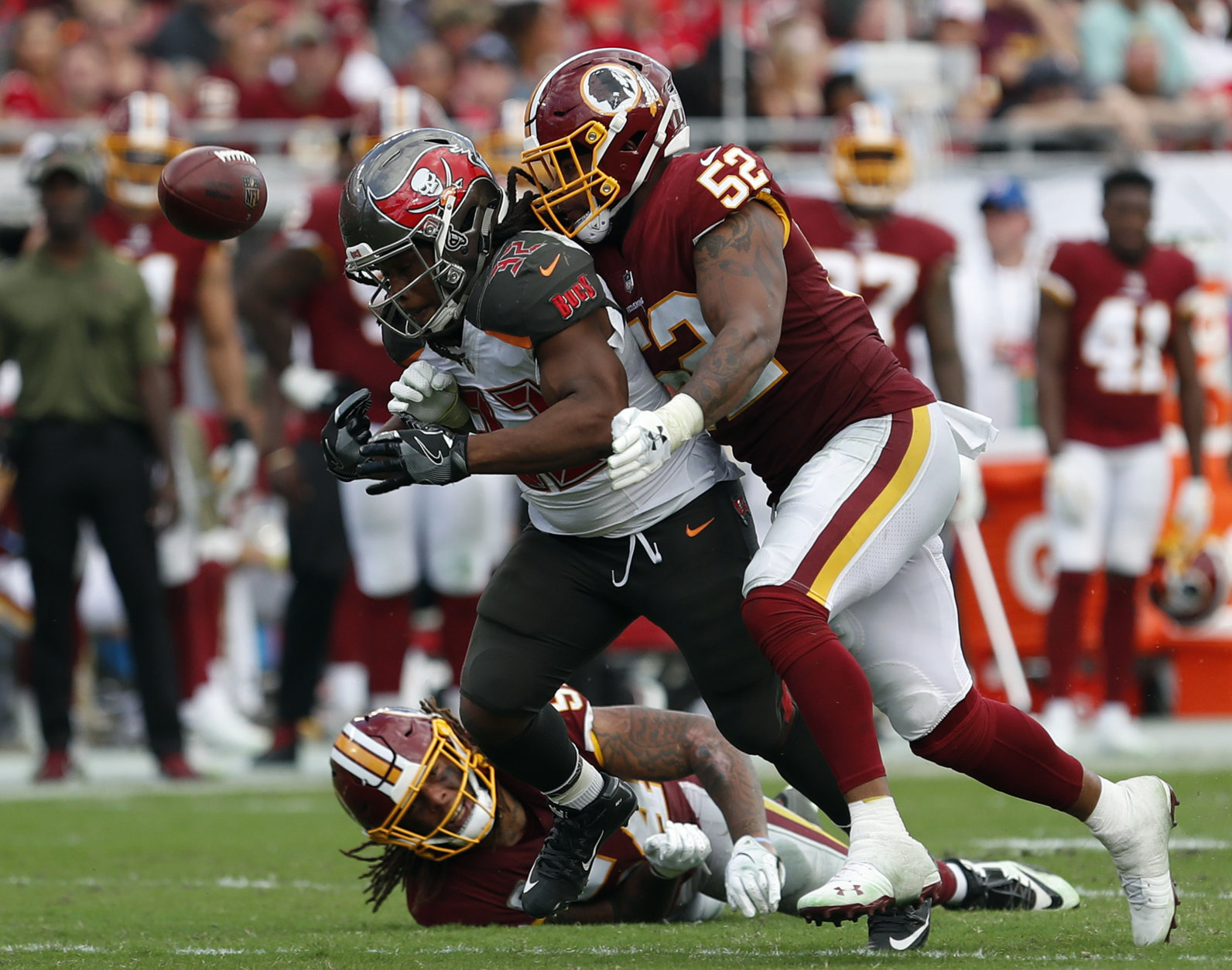 Tampa Bay Buccaneers running back Jacquizz Rodgers (32) fumbles as he is hit by Washington Redskins linebacker Ryan Anderson (52) during the second half of an NFL football game Sunday, Nov. 11, 2018, in Tampa, Fla. (AP Photo/Mark LoMoglio)