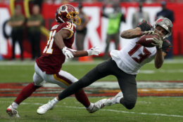 Tampa Bay Buccaneers wide receiver Mike Evans (13) makes a reception in front of Washington Redskins cornerback Fabian Moreau (31) during the second half of an NFL football game Sunday, Nov. 11, 2018, in Tampa, Fla. (AP Photo/Mark LoMoglio)
