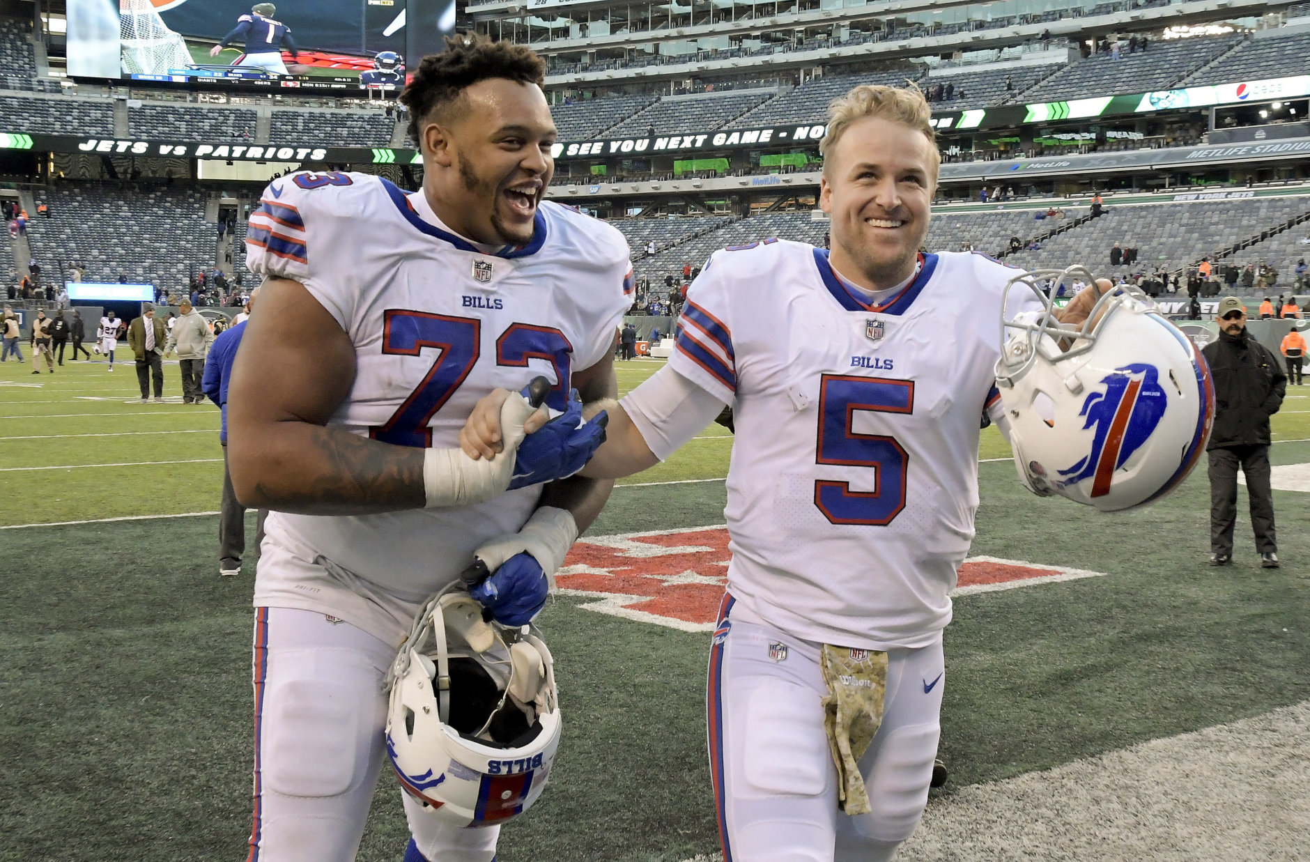Buffalo Bills quarterback Matt Barkley (5) and Buffalo Bills offensive tackle Dion Dawkins (73) walk off the field after an NFL football game against the New York Jets, Sunday, Nov. 11, 2018, in East Rutherford, N.J. (AP Photo/Bill Kostroun)