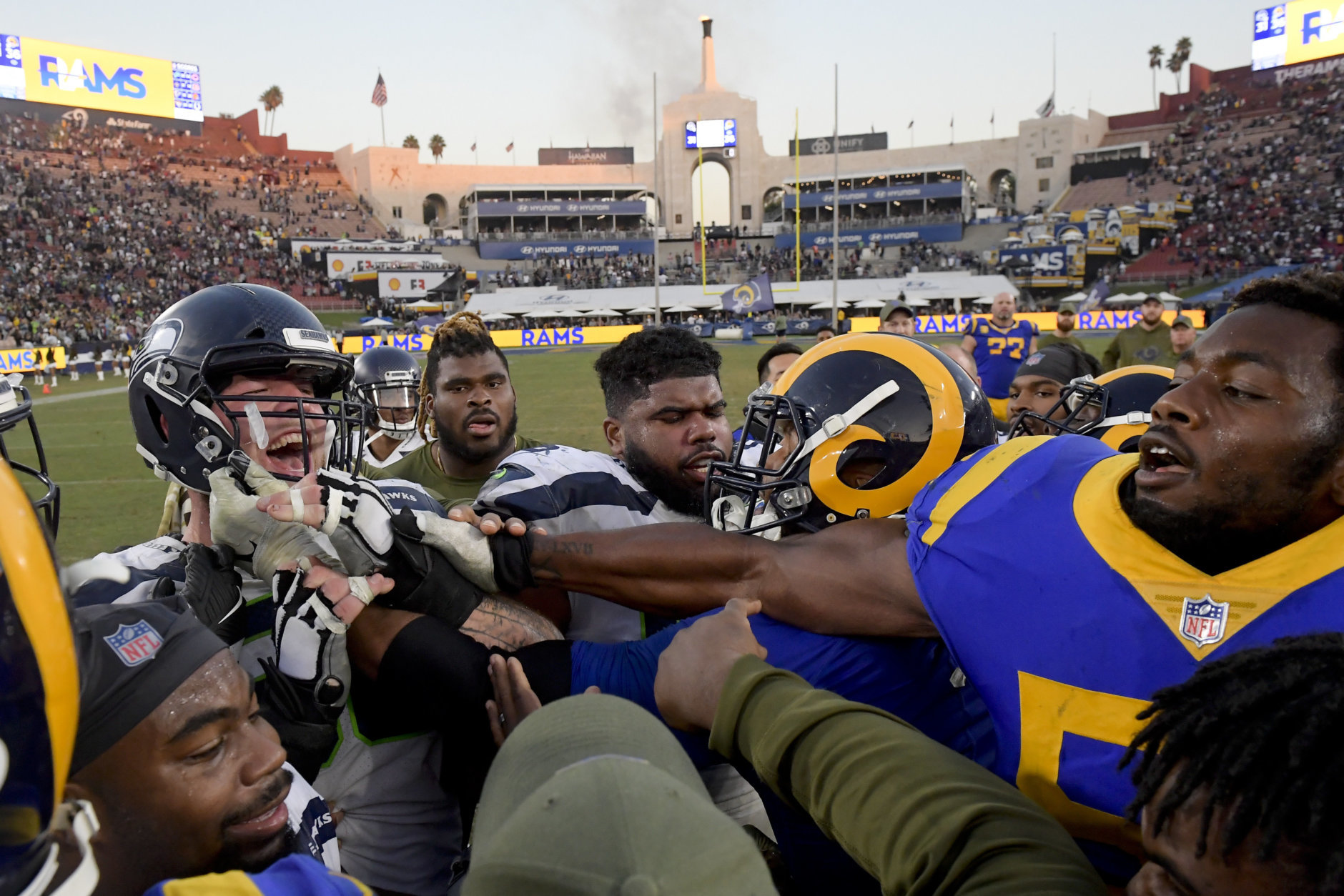 Seattle Seahawks center Justin Britt, left, and Los Angeles Rams defensive end Dante Fowler fight after an NFL football game Sunday, Nov. 11, 2018, in Los Angeles.the Rams won 31-36. (AP Photo/Mark J. Terrill)