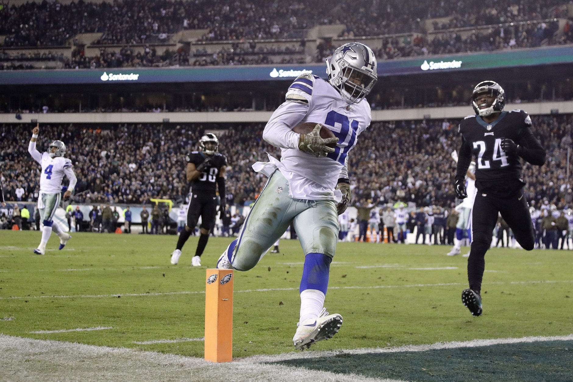 Dallas Cowboys running back Ezekiel Elliott (21) scores on a touchdown pass from quarterback Dak Prescott (4) as Philadelphia Eagles free safety Corey Graham (24) tries to stop him during the second half of an NFL football game, Sunday, Nov. 11, 2018, in Philadelphia. (AP Photo/Matt Slocum)