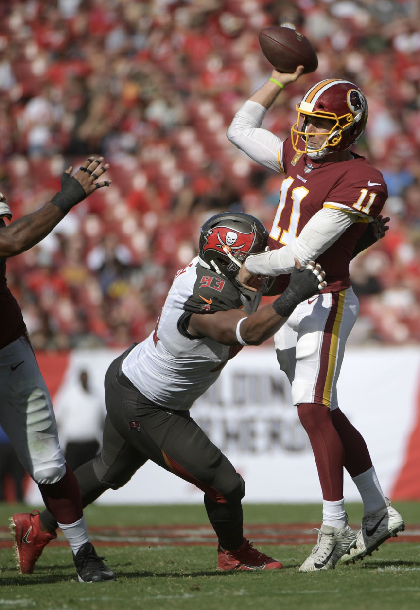 Washington Redskins quarterback Alex Smith (11) throws a pass while under pressure from Tampa Bay Buccaneers defensive tackle Gerald McCoy (93) during the first half of an NFL football game Sunday, Nov. 11, 2018, in Tampa, Fla. (AP Photo/Phelan M. Ebenhack)