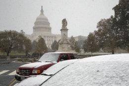 The first snow of the season falls on the Capitol in Washington, Thursday, Nov. 15, 2018. (AP Photo/J. Scott Applewhite)