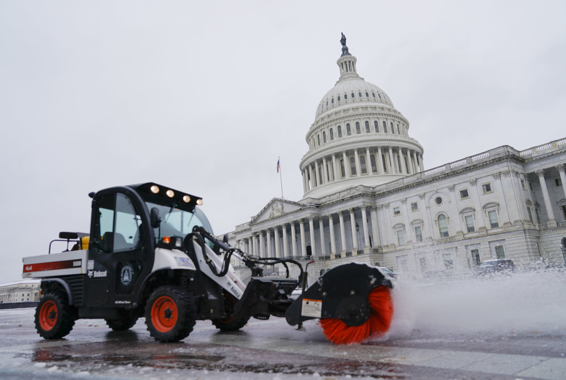 Worker clears the first snow of the season in front of the Capitol in Washington, Thursday, Nov. 15, 2018. (AP Photo/Pablo Martinez Monsivais)