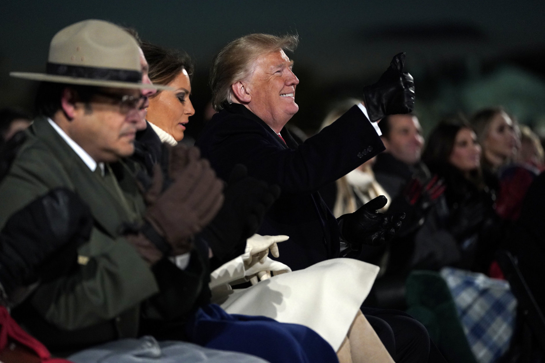 President Donald Trump and first lady Melania Trump attend the National Christmas Tree lighting ceremony on the Ellipse near the White House in Washington, Wednesday, Nov. 28, 2018. (AP Photo/Andrew Harnik)