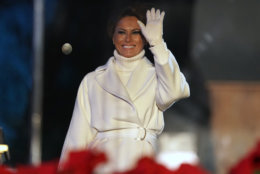 Ffirst lady Melania Trump waves after lighting the National Christmas Tree during a ceremony on the Ellipse near the White House in Washington, Wednesday, Nov. 28, 2018. (AP Photo/Andrew Harnik)