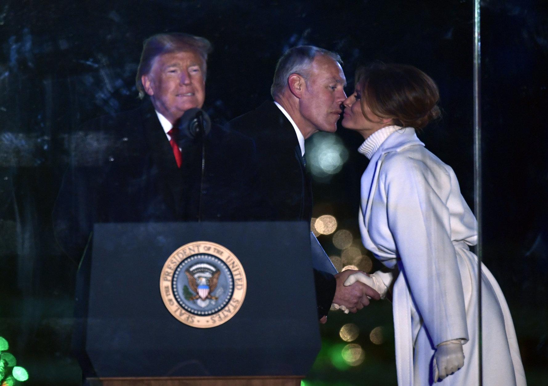 Interior Secretary Ryan Zinke greets first lady Melania Trump before President Donald Trump speaks during the National Christmas Tree Lighting ceremony on the Ellipse in Washington, Wednesday, Nov. 28, 2018. (AP Photo/Susan Walsh)