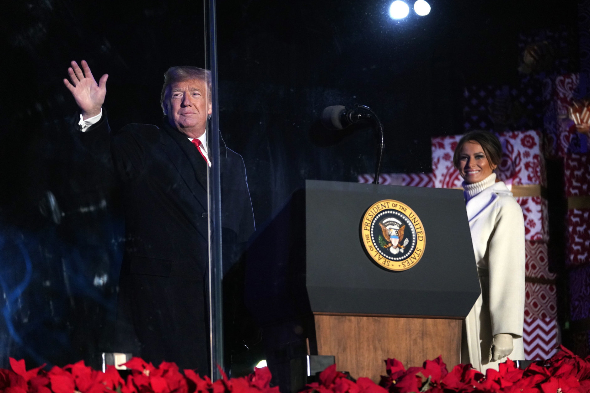President Donald Trump and first lady Melania Trump wave during the National Christmas Tree lighting ceremony at the Ellipse near the White House in Washington, Wednesday, Nov. 28, 2018. (AP Photo/Andrew Harnik)