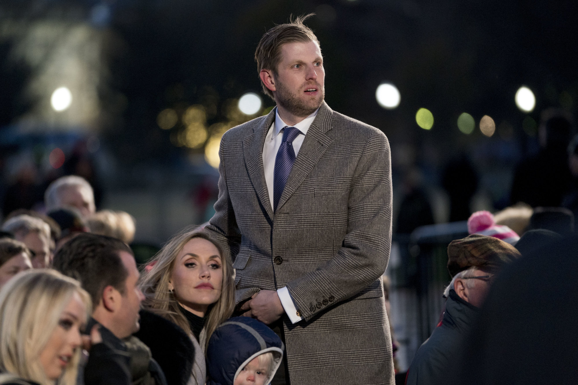 Eric Trump, the son of President Donald Trump and his wife Lara Trump arrive ahead of President Donald Trump and first lady Melania Trump at the National Christmas Tree lighting ceremony at the Ellipse near the White House in Washington, Wednesday, Nov. 28, 2018. (AP Photo/Andrew Harnik)
