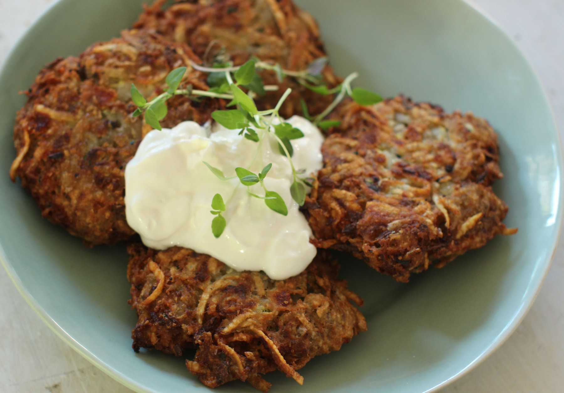 This Oct. 19, 2015 photo shows zesty zucchini and feta latkes in Concord, N.H. This dish is from a recipe by Alison Ladman. (AP Photo/Matthew Mead)