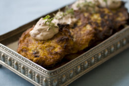 This Oct. 7, 2013 photo shows pumpkin latkes with spiced cranberry sour cream in Concord, N.H. Though potatoes have their own symbolism in the Jewish holiday of Hanukkah, it is the oil used in the frying that is particularly significant; it symbolizes the long-lasting oil burned in the temple lamps in the story of Hanukkah. And that is why there are so many latke variations, including sweet potato, onion and carrot. (AP Photo/Matthew Mead)