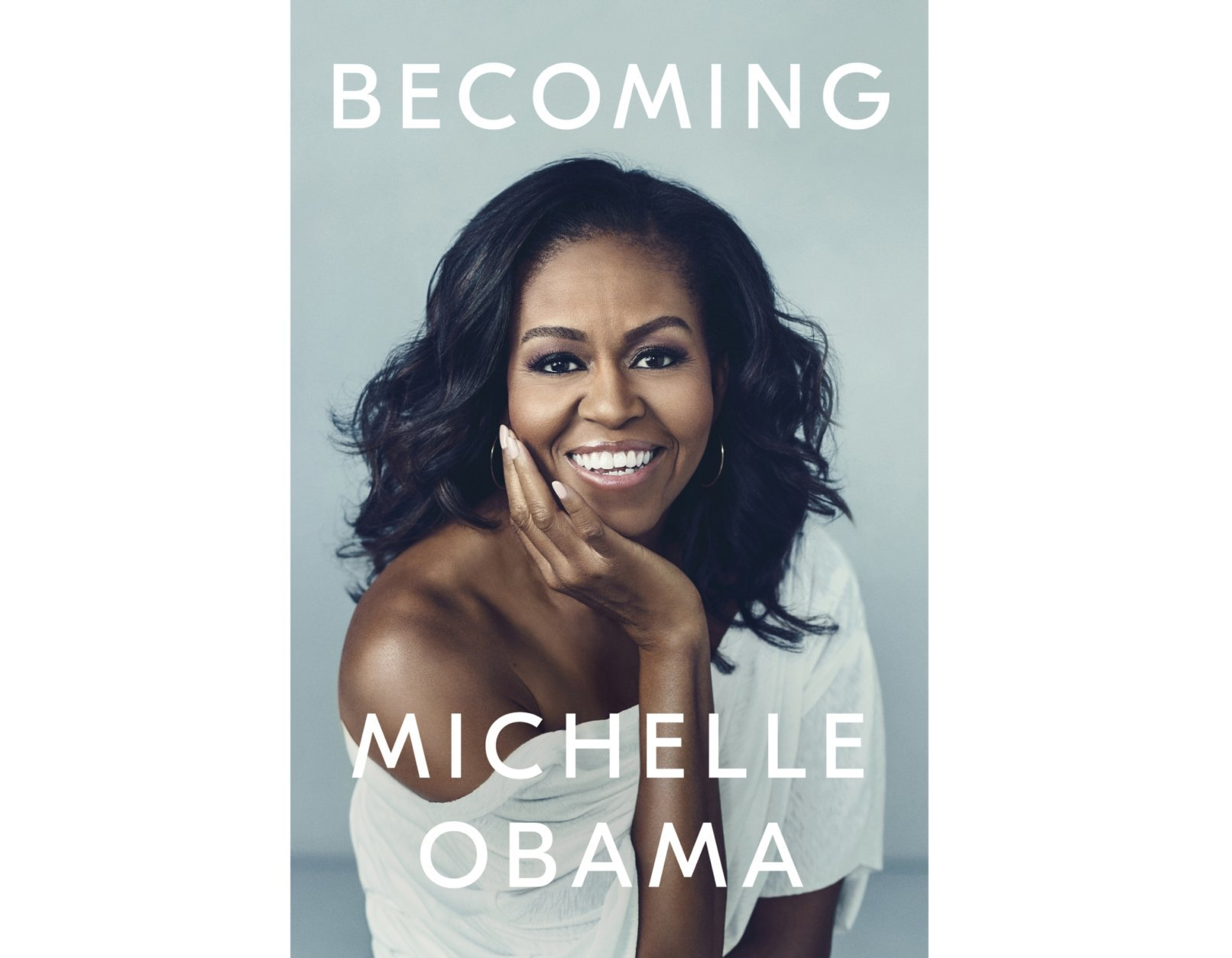 """This cover image released by Crown shows """"Becoming,"""" by Michelle Obama. Crown Publishing told The Associated Press on Friday that the former first lady's memoir had sold more than 725,000 copies after its first day of publication. """"Becoming"""" came out Tuesday, the same day Obama launched a national book tour. (Crown via AP)"""