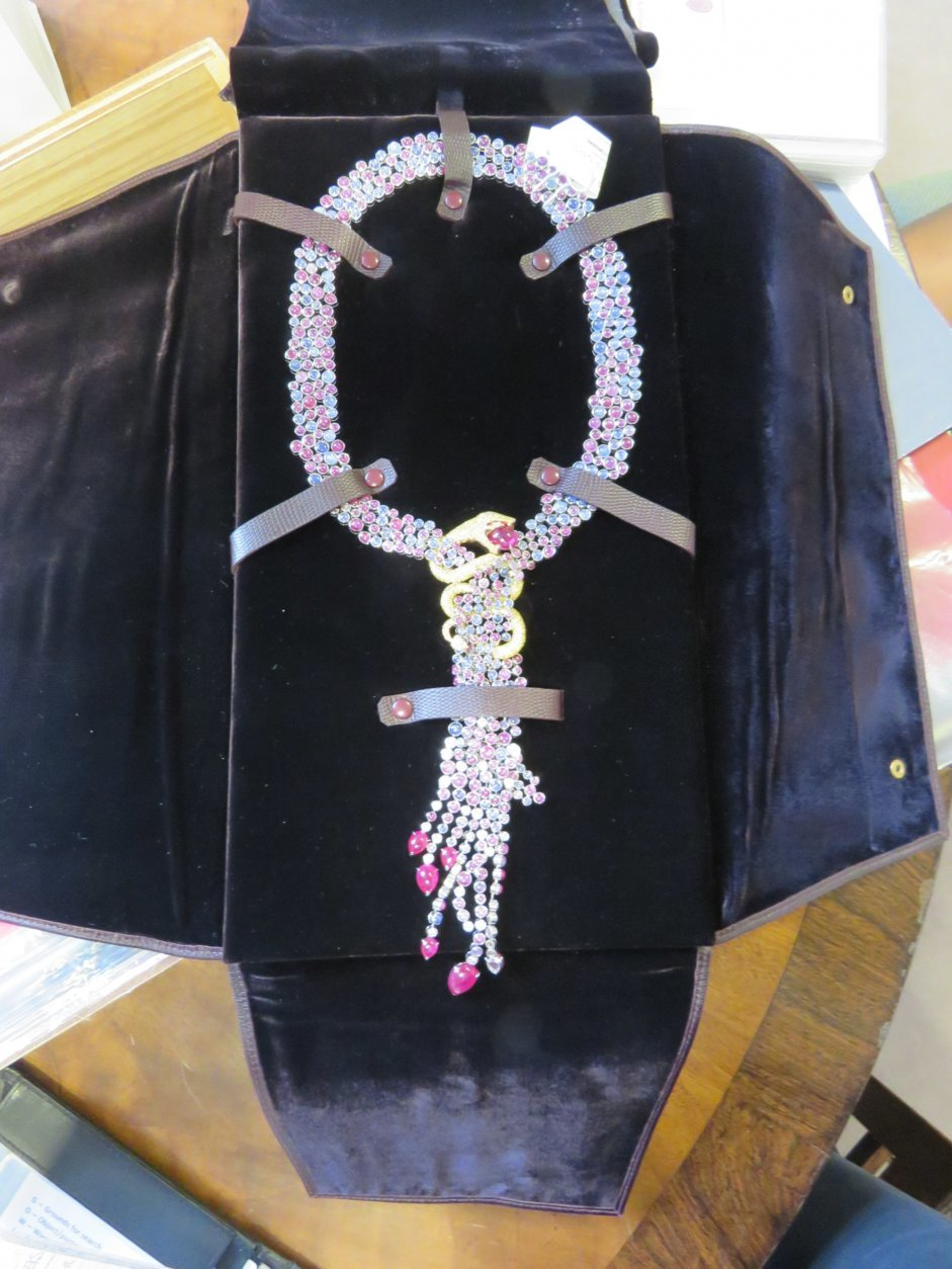 This photo made available by the National Crime Agency shows a sapphire and ruby serpent pendant, one of the 49 items of jewelry worth 400,000 pounds seized by Britain's National Crime Agency from Christie's auction house. The agency says they are linked to Zamira Hajiyeva, who is the subject of an investigation into the source of her wealth. Zamira Hajiyeva, a woman from Azerbaijan, whose fortune has been targeted by British authorities under anti-corruption laws was freed on bail Thursday while she battles extradition to her homeland over embezzlement allegations. (National Crime Agency via AP)