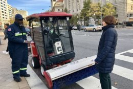 Nevelion Williams of D.C.'s Department of Public Works briefs D.C. Council Committee on Transportation and the Environment chair Mary Cheh on newly purchased snow removal equipment. It's called a Ventrac. (Courtesy Kelly Whittier)