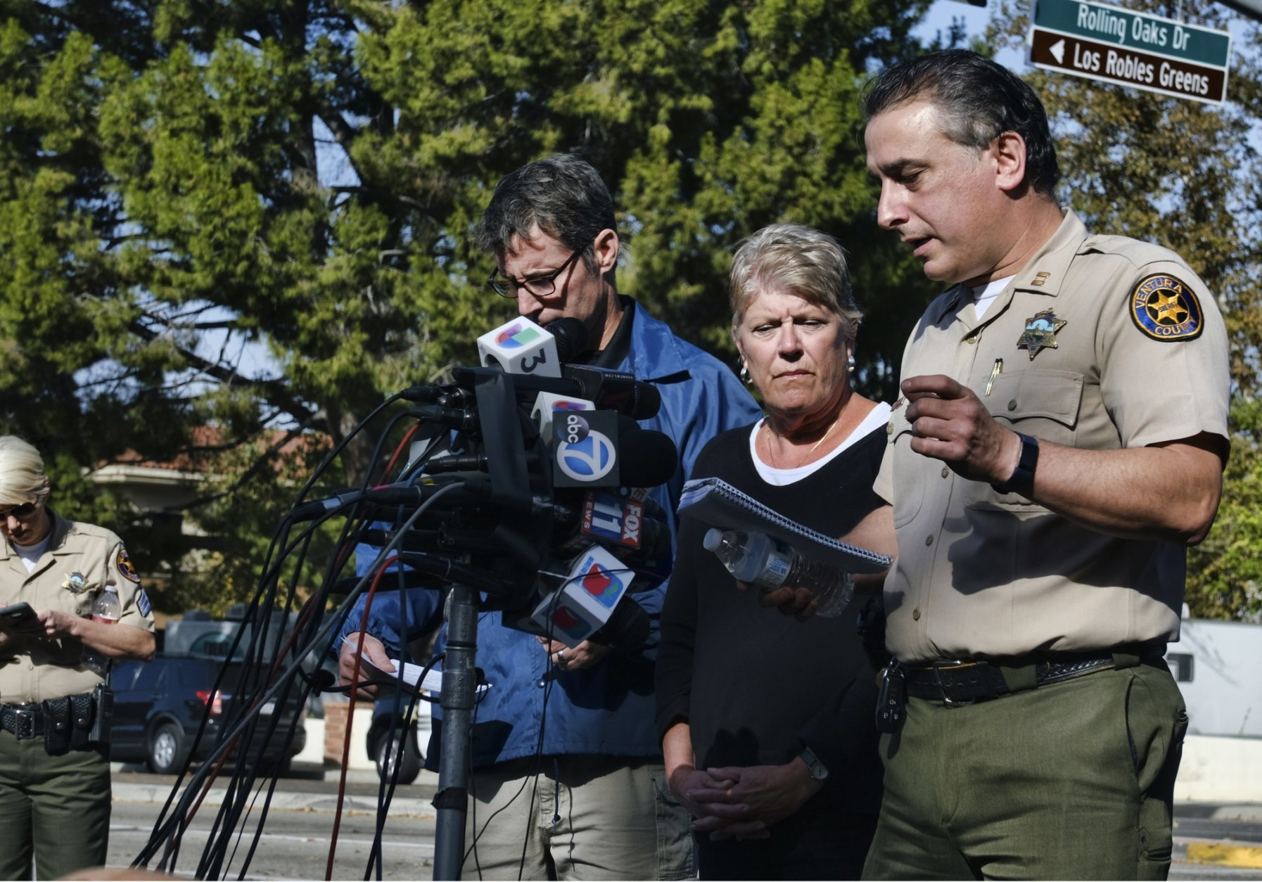 Standing at the microphones, from left to right, Paul Delacourt, assistant director for the FBI Los Angeles, and U.S. Rep. Julia Brownley look on as Ventura County Sheriff's Capt. Garo Kuredjian speaks to the media, Thursday, Nov. 8, 2018, in Thousand Oaks, Calif. Multiple people were fatally shot late Wednesday by the gunman who opened fire at the Borderline Bar and Grill, which was holding a weekly country music dance night for college students. (AP Photo/Richard Vogel)