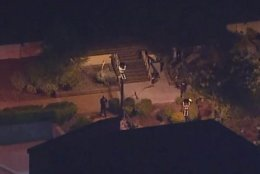 In this image made from aerial video, police move through the vicinity of a shooting in Thousand Oaks, California, early Thursday, Nov. 8, 2018. Authorities say there were multiple injuries _ including one officer _ after a man opened fire in Southern California bar late Wednesday. (KABC via AP)