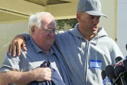 Jason Coffman, right, talks to the media about his son, Cody Coffman, who died in the shooting, and holds onto his father-in-law, Mike Johnston, in Thousand Oaks, Calif., Thursday, Nov. 8, 2018. (AP Photo/Jonathan J. Cooper)