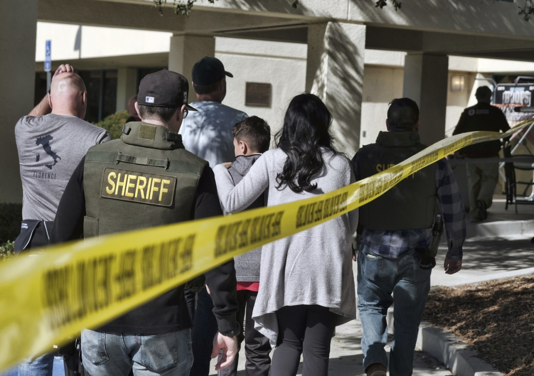 Family members are led into the Thousand Oaks Teen Center where families have gathered after a deadly shooting at a bar on Thursday, Nov. 8,2018, in Thousand Oaks, Calif. Multiple people were shot and killed late Wednesday by the gunman who opened fire at the Borderline Bar & Grill, which was holding a weekly country music dance night for college students. (AP Photo/Richard Vogel)