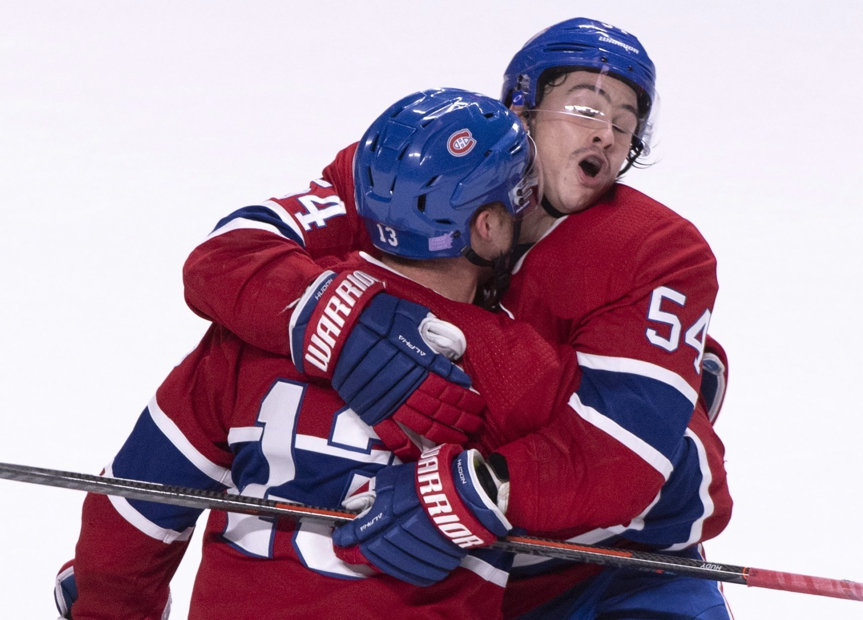Montreal Canadiens' Charles Hudon hugs teammate Max Domi following Domi's goal past Washington Capitals goaltender Braden Holtby during third period NHL hockey action in Montreal on Thursday, Nov. 1, 2018. (Paul Chiasson/The Canadian Press via AP)