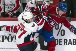 Montreal Canadiens' Mike Reilly fends off Washington Capitals' T.J. Oshie during second period NHL hockey action in Montreal on Thursday, Nov. 1, 2018. (Paul Chiasson/The Canadian Press via AP)