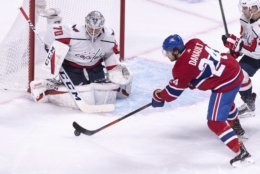 Montreal Canadiens' Phillip Danault fires a shot to Washington Capitals goaltender Braden Holtby during first period NHL hockey action in Montreal on Thursday, Nov. 1, 2018. (Paul Chiasson/The Canadian Press via AP)