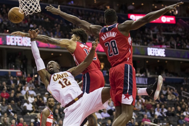 37ea1f021 Cleveland Cavaliers guard David Nwaba (12) tries to shoot past Washington  Wizards forward Kelly Oubre Jr. (12) and center Ian Mahinmi (28)