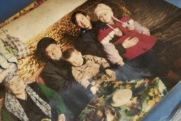 """This undated photo provided by Ablikim Abliz, shows his uncle's family posing with an unknown Han Chinese man, second from the right, in Istanbul, Turkey. Abliz heard the Han Chinese man was part of a government homestay program meant to monitor his relatives, part of a broader crackdown on religious expression in China's far western region of Xinjiang. More than a million Chinese civil servants have been assigned to move into the homes of Uighurs and other ethnic minorities, spending weeks as uninvited guests. While government notices about the """"Pair Up and Become Family"""" program portray it as an affectionate cultural exchange, exiled Uighurs living in Turkey said their loved ones saw the campaign as a chilling intrusion, aimed at coercing Uighurs into living secular lives like the Han majority. (Ablikim Abliz via AP)"""