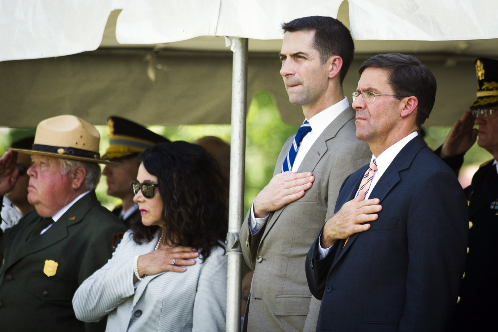 In this Sept. 6, 2018 photo, P. Daniel Smith; deputy director, National Park Service, left, Karen Durham-Aquilere; executive director, Army National Military Cemeteries, second from left, and Mark Esper, Secretary of the Army, right, participate in a military funeral with honors for two Civil War Union soldiers at their grave at Arlington National Cemetery in Arlington, Va. The U.S. Army is being criticized for reburying the remains of two recently discovered Civil War soldiers without conducting DNA testing. The soldiers were found at Manassas National Battlefield, among severed limbs in what researchers believe was a surgeon's pit. Army officials said DNA testing was unjustified and reburied them as unknown soldiers at Arlington National Cemetery. (AP Photo/Cliff Owen)