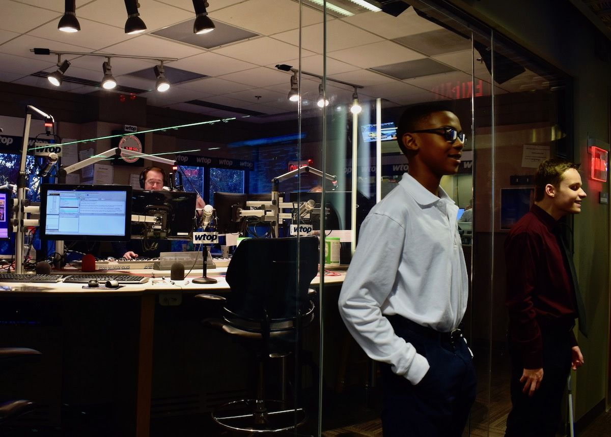 Sylvestre and Friedrich pose in front of the main studio as the afternoon anchors go live. (WTOP/Teta Alim)