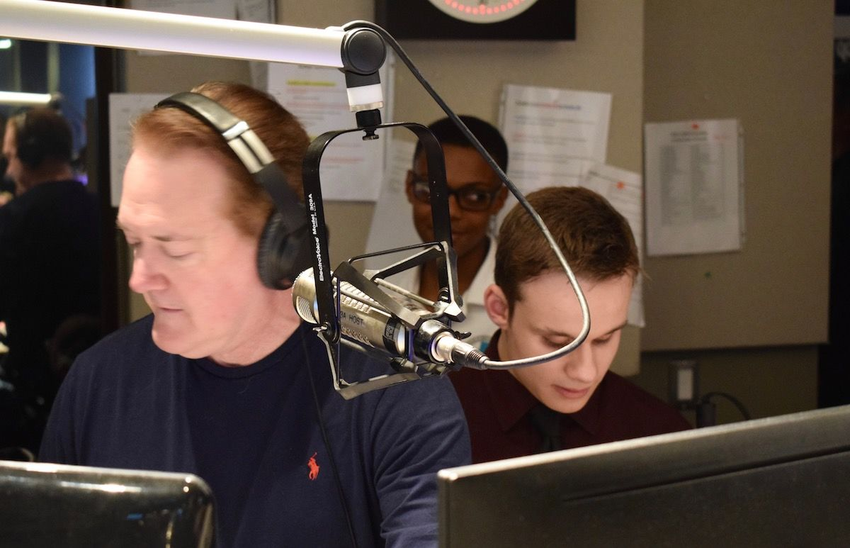 Anderson goes on air as the contest winners look on. (WTOP/Teta Alim)