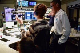 Howard gives them a quick preview of the work she does. (WTOP/Teta Alim)