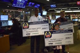 (From left to right) Sylvestre, Basri and Friedrich pose with another element of their prizes. (WTOP/Teta Alim)