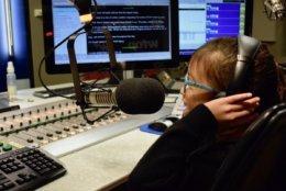Basri records a weather alert in a WTOP studio. (WTOP/Teta Alim)