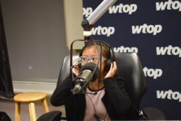 Basri shows off her anchor chops in a WTOP studio. (WTOP/Teta Alim)