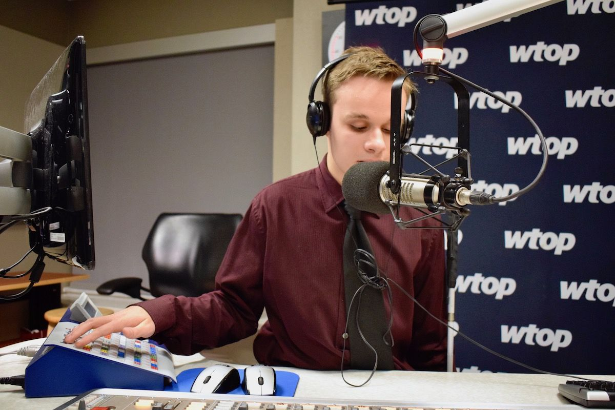Friedrich gets into anchor-mode and delivers a breaking-news ready report. (WTOP/Teta Alim)
