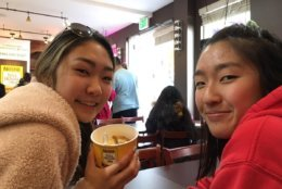 Camryn Yi (left) and her sister Madelyn (right) were waiting for their order of a dozen cookies. (WTOP/Liz Anderson)