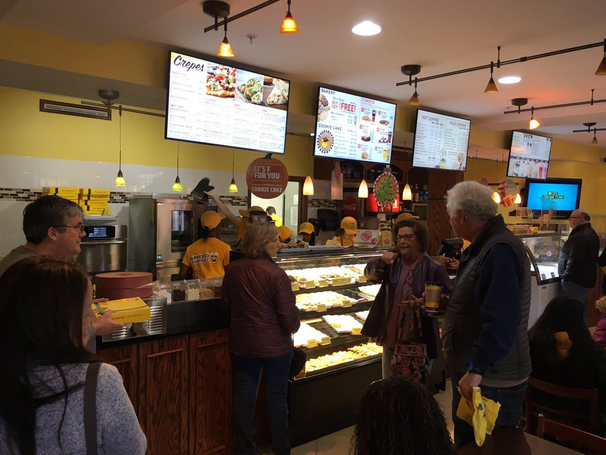 People stood in line to try the newest cafe in town. (WTOP/Liz Anderson)