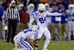 Duke kicker Collin Wareham (94) kicks his second field goal of the night, with Jackson Hubbard holding during the first half of an NCAA college football game against Clemson on Saturday, Nov. 17, 2018, in Clemson, S.C. (AP Photo/Richard Shiro)