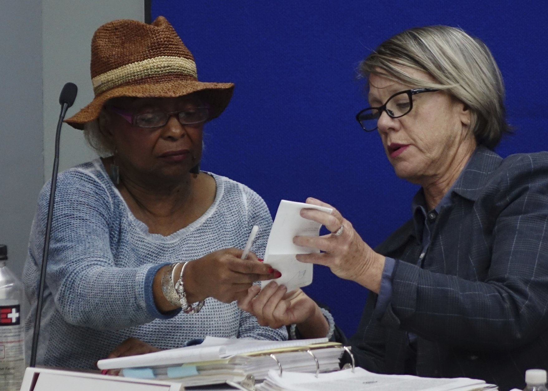 Broward Supervisor of Elections Brenda Snipes, left, and judge Betsy Benson of the election canvassing board, listen to arguments, Sunday, Nov. 11, 2018, at the Broward Supervisor of Elections office in Lauderhill, Fla. (Joe Cavaretta /South Florida Sun-Sentinel via AP)