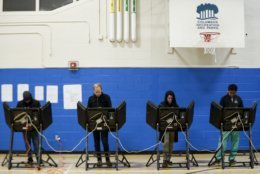 Voters cast their ballots at the Tuttle Park Recreation Center polling location, Tuesday, Nov. 6, 2018, in Columbus, Ohio. Across the country, voters headed to the polls Tuesday in one of the most high-profile midterm elections in years. (AP Photo/John Minchillo)